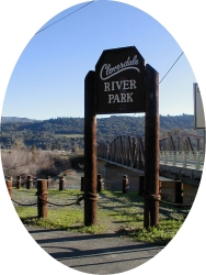 A large wooden sign near a wooded area